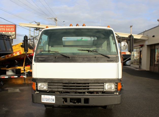 B. 1995 Mitsubishi Fuso Spray Unit Flatbed Truck from Town and Country Commercial Trailer and Truck Sales, Kent (Seattle), WA