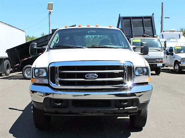 6021.D. 2002Ford F450 Super Duty 4 door crew cab 9 ft. flatbed truck from Town and Country Commercial Truck and Trailer Sales, Kent (Seattle), WA