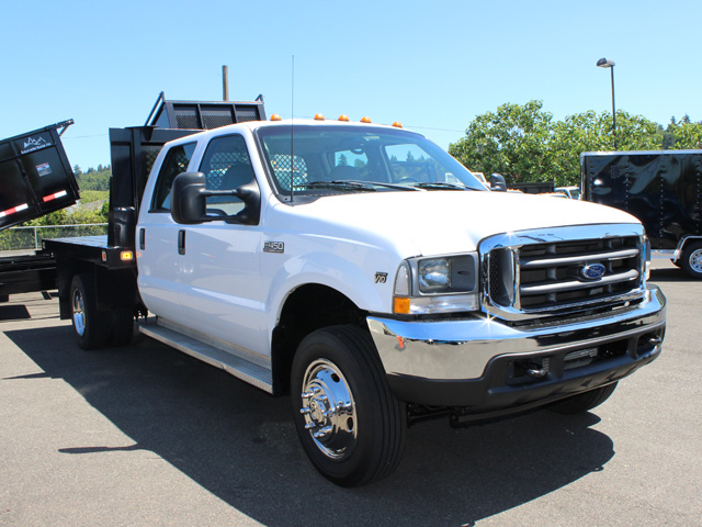 6021.E. 2002Ford F450 Super Duty 4 door crew cab 9 ft. flatbed truck from Town and Country Commercial Truck and Trailer Sales, Kent (Seattle), WA