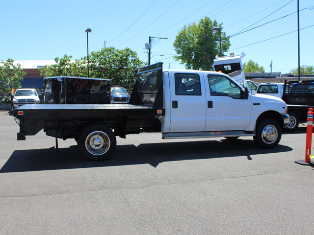 6021.F. 2002Ford F450 Super Duty 4 door crew cab 9 ft. flatbed truck from Town and Country Commercial Truck and Trailer Sales, Kent (Seattle), WA