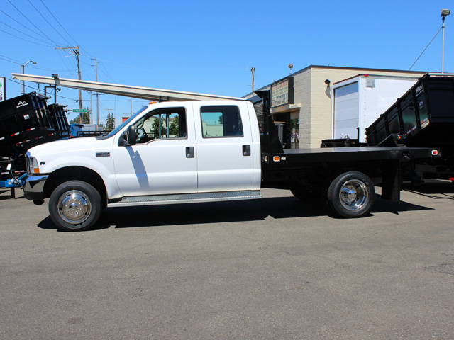 6021.G. 2002Ford F450 Super Duty 4 door crew cab 9 ft. flatbed truck from Town and Country Commercial Truck and Trailer Sales, Kent (Seattle), WA
