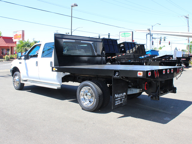6021.H. 2002Ford F450 Super Duty 4 door crew cab 9 ft. flatbed truck from Town and Country Commercial Truck and Trailer Sales, Kent (Seattle), WA