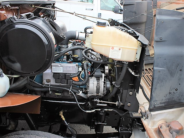 6055.E. 2002 INTERNATIONAL 4700 Non-CDL 12 ft. flatbed dump truck from Town and Country Commercial Truck and Trailer Sales, Kent (Seattle), WA