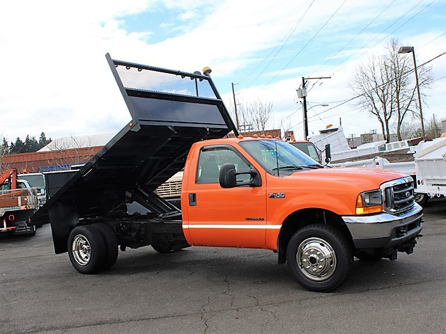 6127.B. 1999 Ford F450 4x4 12 ft. flatbed dump truck from Town and Country Commercial Truck and Trailer Sales, Kent (Seattle), WA