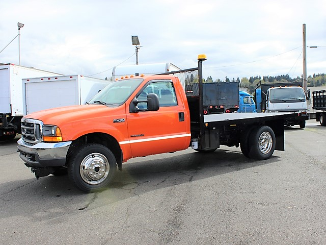 6127.C. 1999 Ford F450 4x4 12 ft. flatbed dump truck from Town and Country Commercial Truck and Trailer Sales, Kent (Seattle), WA
