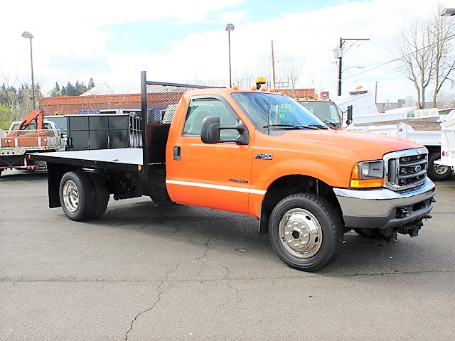 6127.D. 1999 Ford F450 4x4 12 ft. flatbed dump truck from Town and Country Commercial Truck and Trailer Sales, Kent (Seattle), WA