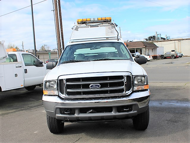 6128.C. 2004 Ford F250 4x4 Super Duty X-Cab4 door 8 ft. flatbed dump truck from Town and Country Commercial Truck and Trailer Sales, Kent (Seattle), WA