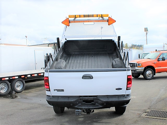 6128.F. 2004 Ford F250 4x4 Super Duty X-Cab4 door 8 ft. flatbed dump truck from Town and Country Commercial Truck and Trailer Sales, Kent (Seattle), WA