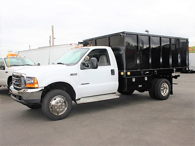 6125. 2001 FORD F550 Super Duty flatbed dump truck from Town and Country Commercial Truck and Trailer Sales, Kent (Seattle), WA