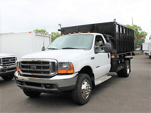 6125.B. 2001 FORD F550 Super Duty flatbed dump truck from Town and Country Commercial Truck and Trailer Sales, Kent (Seattle), WA