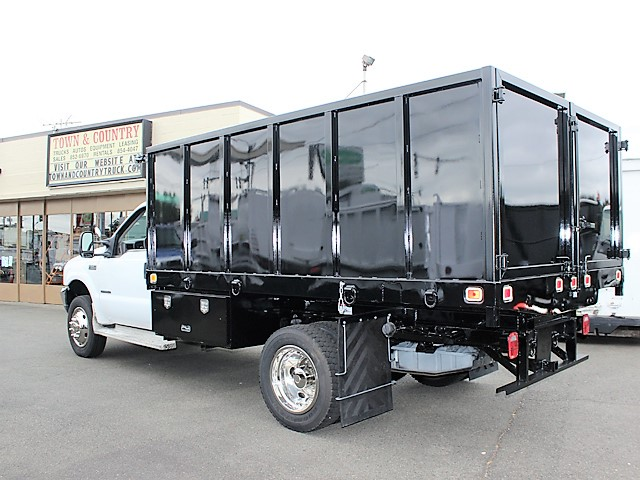 6125.H. 2001 FORD F550 Super Duty flatbed dump truck from Town and Country Commercial Truck and Trailer Sales, Kent (Seattle), WA