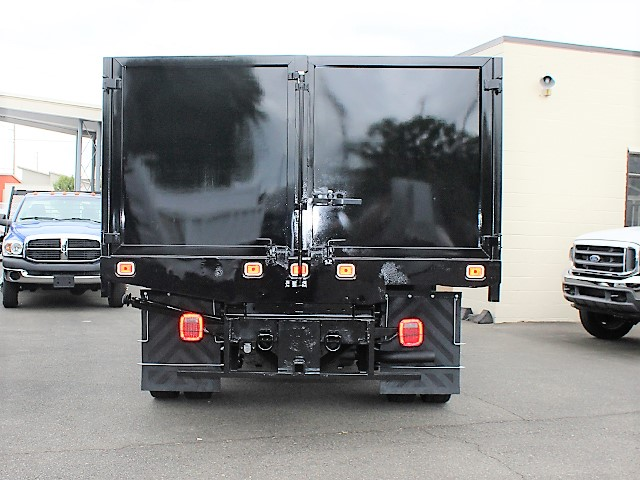 6125.M. 2001 FORD F550 Super Duty flatbed dump truck from Town and Country Commercial Truck and Trailer Sales, Kent (Seattle), WA