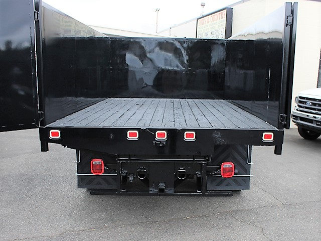 6125.N. 2001 FORD F550 Super Duty flatbed dump truck from Town and Country Commercial Truck and Trailer Sales, Kent (Seattle), WA