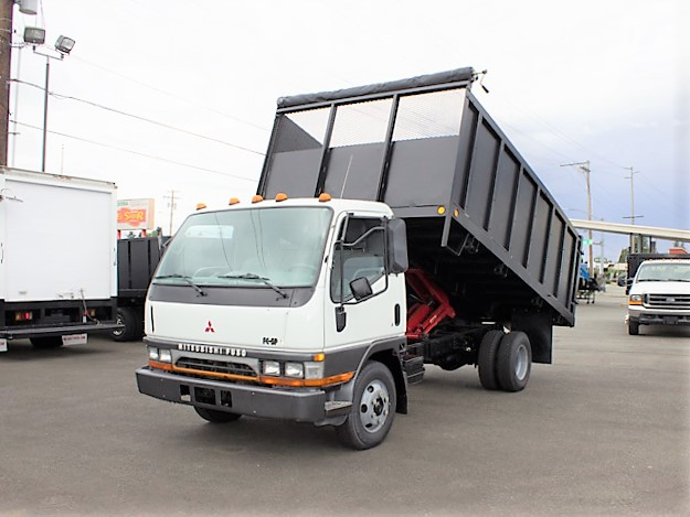 6353.A. 1996 Mitsubishi FE SP 14 ft. flatbed dump truck from Town and Country Commercial Truck and Trailer Sales, Kent (Seattle), WA.