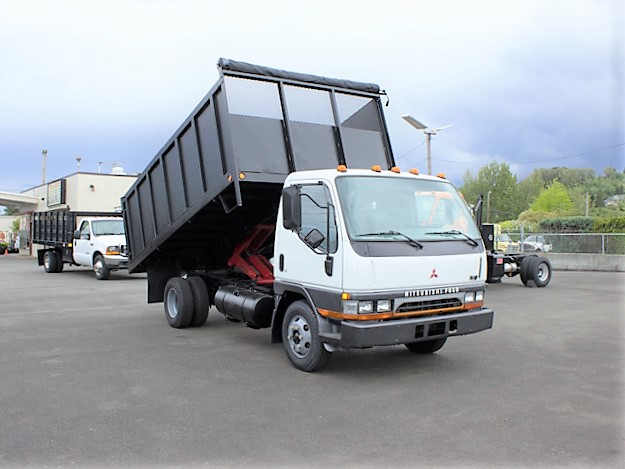 6353.B. 1996 Mitsubishi FE SP 14 ft. flatbed dump truck from Town and Country Commercial Truck and Trailer Sales, Kent (Seattle), WA.