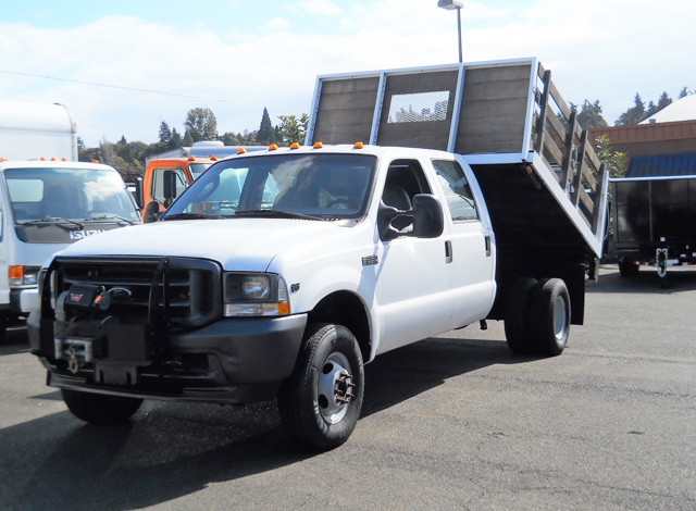 2003 FORD F350 Super Duty 9 ft. crew cab flatbed dump truck from Town and Country Commercial Truck and Trailer Sales, Kent (Seattle), WA.