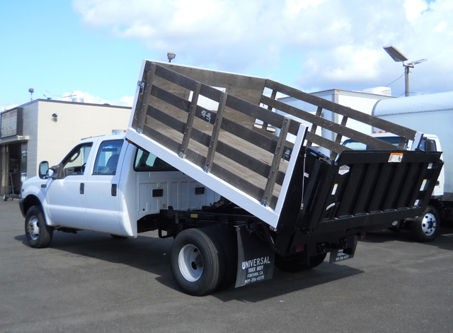 6374.C.2003 FORD F350 Super Duty 9 ft. crew cab flatbed dump truck from Town and Country Commercial Truck and Trailer Sales, Kent (Seattle), WA.