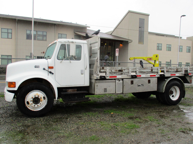 2000 INTERNATIONAL 4700 16 ft. flatbed dump truck from Town and Country Commercial Truck and Trailer Sales, Kent (Seattle), WA.