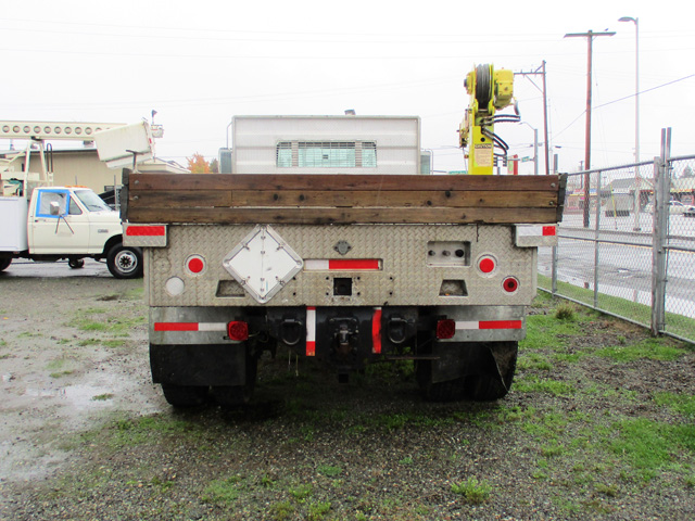 ES2000.H. 2000 INTERNATIONAL 4700 16 ft. flatbed dump truck from Town and Country Commercial Truck and Trailer Sales, Kent (Seattle), WA.