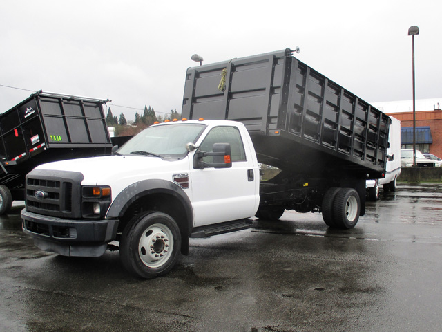 2009 FORD f550 14 ft. Flatbed Dump Truck from Town and Country Truck and Trailer Sales, Kent (Seattle), WA.