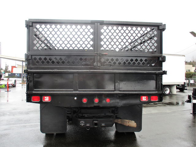 6371.G. 2009 FORD f550 14 ft. Flatbed Dump Truck from Town and Country Truck and Trailer Sales, Kent (Seattle), WA.