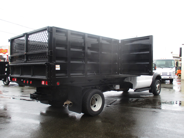6371.L. 2009 FORD f550 14 ft. Flatbed Dump Truck from Town and Country Truck and Trailer Sales, Kent (Seattle), WA.