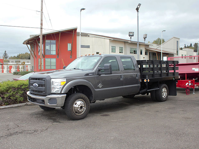 2011 Ford F350 Super Duty one ton Crewcab flatbed truck with stakesides from Town and Country Truck and Trailer Sales, Kent (Seattle), WA.
