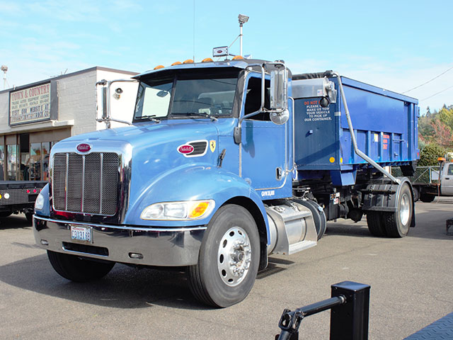 2014 Peterbuilt 337 Non-CDL Roll Off truck from Town and Country Truck and Trailer Sales, Kent (Seattle), WA.