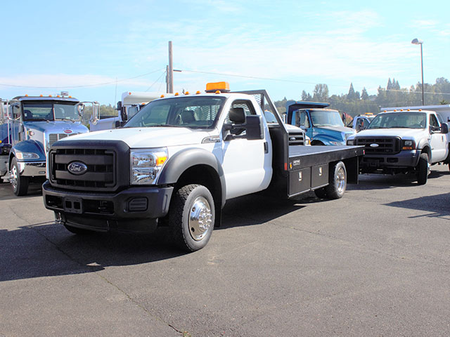 6659.B. 2012 Ford F450 4x4 Superduty 14 ft. flatbed truck from Town and Country Truck and Trailer Sales, Kent (Seattle), WA.